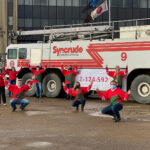 Members of the United Way employee campaign team standing in front of a fire truck