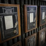 a wall with plaque of patents